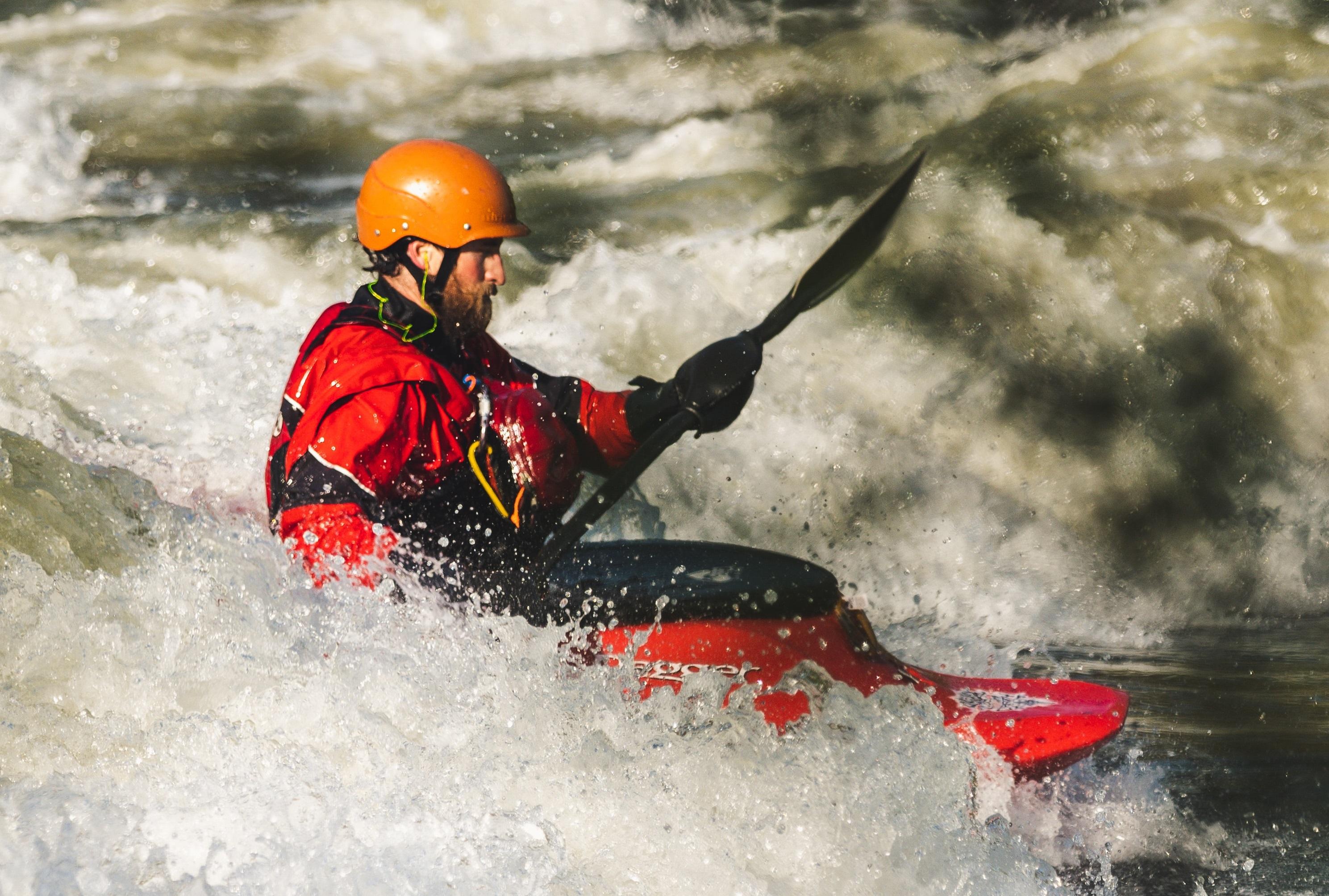 canoeist on white water rapids